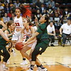 West Las Vegas' Jasmine Sanchez, number 21, and Skylin Morgan, number 32, double team Robertson's Tessa Ortiz, number 24, during the first quarter of the West Las Vegas High School vs Robertson High School at the Santa Ana Star Center during State Championship quarter finals on Tuesday, March 12, 2019. Luis Sánchez Saturno/The New Mexican