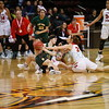 West Las Vegas' Briana Marquez, number 11, recovers a loose ball from Robertson's Gabriela Trujillo, number 12, and Tessa Ortiz, number 24, during the first quarter of the West Las Vegas High School vs Robertson High School at the Santa Ana Star Center during State Championship quarter finals on Tuesday, March 12, 2019. Luis Sánchez Saturno/The New Mexican