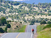 Cyclist on New Mexico State Hwy south of Nogal, New Mexico-00770 - 72 ppi - 2