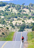 Cyclist on New Mexico State Hwy south of Nogal, New Mexico-00770 - 72 ppi - 4