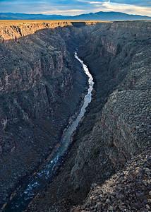 Rio Grande Gorge - sunset view south Canyon walls expose Tertiary basalt flows Santa Fe, New Mexico