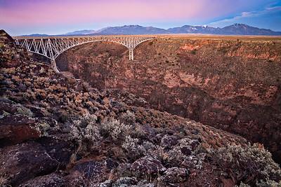 Rio Grande Gorge Bridge - sunset Canyon is cut through Tertiary basalt flows Santa Fe, New Mexico