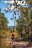 Cyclist on battlefield trail, Glorieta Unit of Pecos Nat'l Historical Park, NM - D4-C3-0273 - 72 ppi