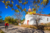 Cyclist passing historic Catholic church in Apache Canyon, NM - D4-C2-0334 - 72 ppi