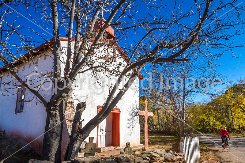 Cyclist passing historic Catholic church in Apache Canyon, NM - D4-C2-0357 - 72 ppi-3