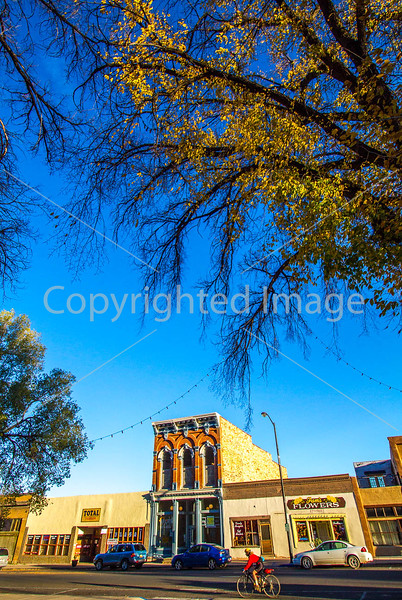 Cyclist at historic downtown plaza in Las Vegas, NM - D4-C2-0513 - 72 ppi