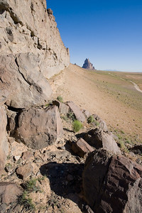 Shiprock, New Mexico Tertiary  volcanic neck and radial dike  Cretaceous Mancos Shale at road level