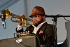 NEW ORLEANS, LA-APRIL 29: Nicholas Payton, playing both trumpet and keyboards, performs at the New Orleans Jazz & Heritage Festival in New Orleans, LA on April 29, 2012. (Photo by Clayton Call/Redferns)