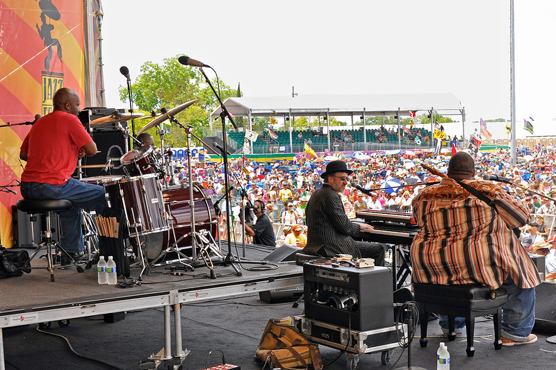"""NEW ORLEANS, LA-APRIL 28: Jon Cleary & The Absolute Monster Gentlemen perform at the New Orleans Jazz & Heritage Festival in New Orleans, LA on April 28, 2012. (L-R): Jeffrey """"Jellybean"""" Alexander, Jon Cleary, Derwin """"Big D"""" Perkins (Photo by Clayton Call/Redferns)"""