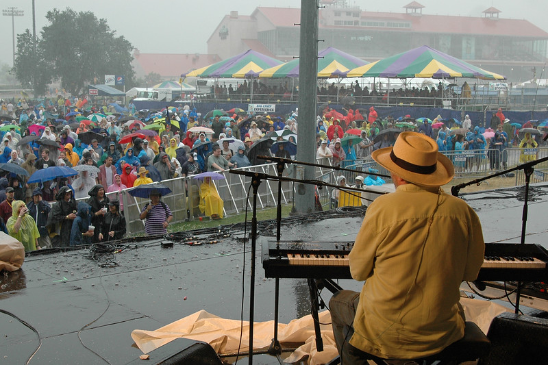 NEW ORLEANS, LA-APRIL 23: Jon Cleary performs in the rain on the Gentilly Stage at the New Orleans Jazz & Heritage Festival on April 23, 2010. (Photo by Clayton Call/Redferns)