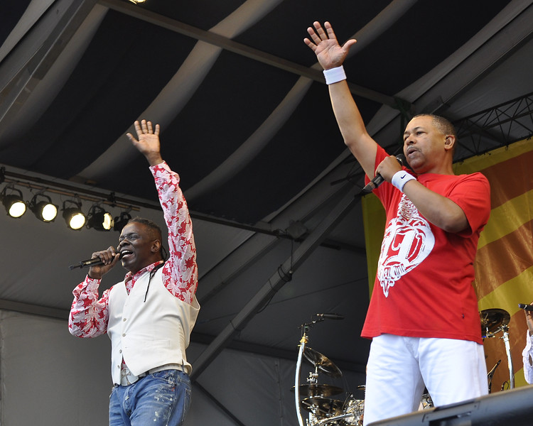 NEW ORLEANS, LA-APRIL 30: (L-R): Phillip Bailey and Ralph Johnson perform with Earth, Wind & Fire on the Acura Stage at the New Orleans Jazz & Heritage Festival on April 30, 2010. (Photo by Clayton Call/Redferns)