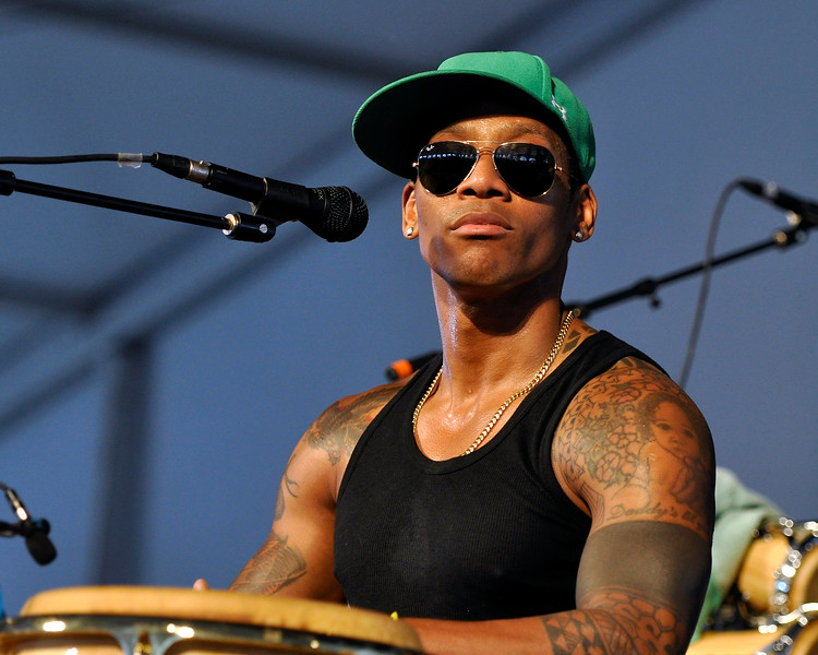 NEW ORLEANS, LA-MAY 5: Pedrito Martinez performs at the New Orleans Jazz & Heritage Festival in New Orleans, LA on May 5, 2012. (Photo by Clayton Call/Redferns)