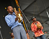 NEW ORLEANS, LA-APRIL 27: Seun Kuti performs at the New Orleans Jazz & Heritage Festival in New Orleans, LA on April 27, 2012. (L-R): Seun Kuti, Okoniyamba (Photo by Clayton Call/Redferns)