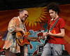 NEW ORLEANS, LA-APRIL 24: (L-R): George Porter, Jr. and Ian Neville perform with the Funky Meters at the New Orleans Jazz & Heritage Festival on April 24, 2010. (Photo by Clayton Call/Redferns)