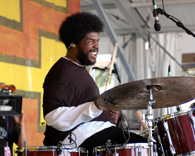 "Ahmir ""?uestlove"" Thompson performing live on stage with The Roots at the New Orleans Jazz & Heritage Festival on May 3, 2008."