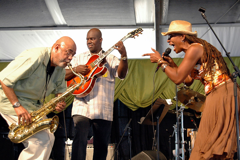 Reggie Houston (L) performing with Charmaine Neville at the New Orleans Jazz & Heritage Festival on April 28, 2006.