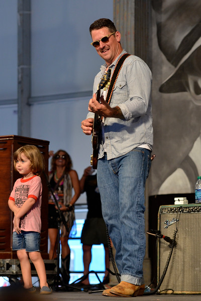 NEW ORLEANS, LA-APRIL 27: Eric Lindell (with his daughter) performs at the New Orleans Jazz & Heritage Festival in New Orleans, LA on April 27, 2012. (Photo by Clayton Call/Redferns)
