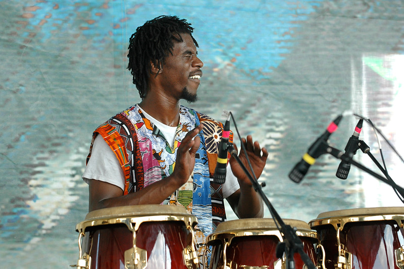 Percussionist from the New Orleans Nightcrawlers brass band performing live on stage at the New Orleans Jazz & Heritage Festival on May 1, 2008.