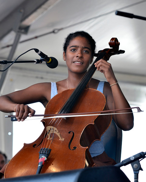NEW ORLEANS, LA-APRIL 28: Leyla McCalla performs with the Carolina Chocolate Drops at the New Orleans Jazz & Heritage Festival in New Orleans, LA on April 28, 2012. (Photo by Clayton Call/Redferns)
