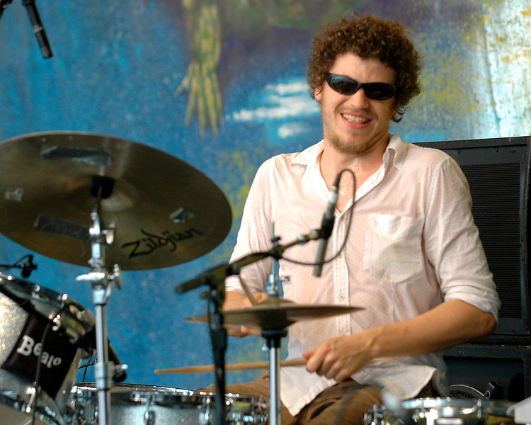 Simon Lott (Charie Hunter Trio, Anders Osborne) performing live on stage with Anders Osborne at the New Orleans Jazz & Heritage Festival on April 25, 2008.