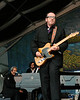 Elvis Costello performing live on stage with the Impostors and special guest Allen Toussaint at the New Orleans Jazz & Heritage Festival on April 27, 2008. ( L-R ) Allen Toussaint, Steve Nieve, Elvis Costello.