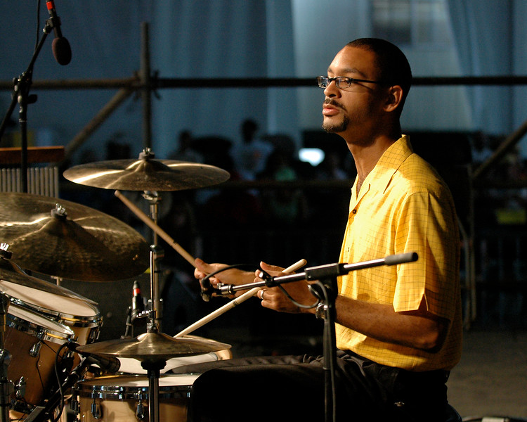 Jason Marsalis sits in with Roland Guerin and Marcus Roberts in addition to his regular set with his father Ellis Marsalis in the Jazz Tent at Jazzfest 2006.
