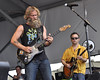 NEW ORLEANS, LA-MAY 1: Anders Osborne (L) and  Will Bernard (R) perform on the Acura Stage at the New Orleans Jazz & Heritage Festival on May 1, 2010. (Photo by Clayton Call/Redferns)