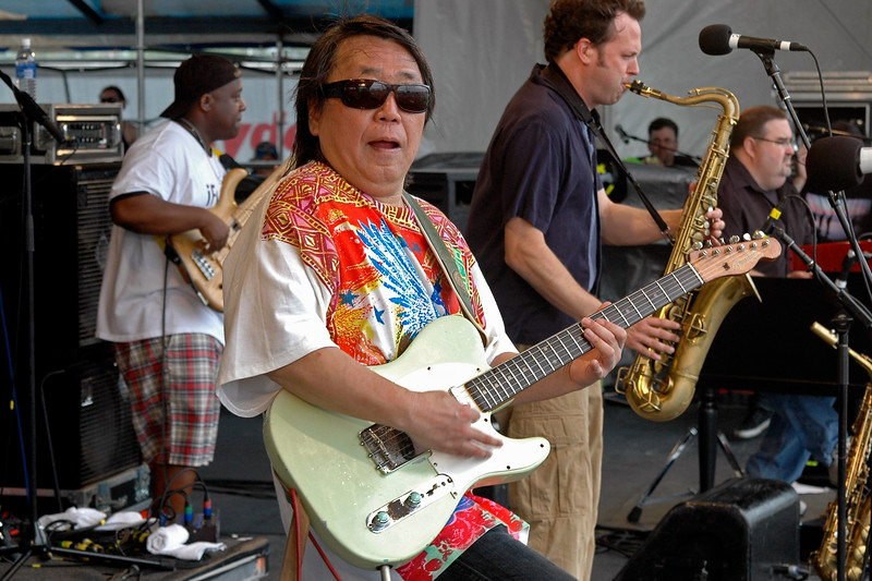 NEW ORLEANS, LA-APRIL 24: Papa Grows Funk performs at the New Orleans Jazz & Heritage Festival on April 24, 2010. (L-R): Marc Pero, June Yamagishi, Jason Mingledorff, John Gros. (Photo by Clayton Call/Redferns)