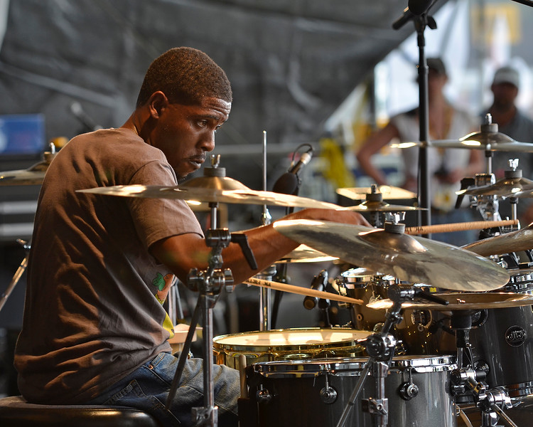 NEW ORLEANS, LA-May 3: Terrence Houston performs with George Porter, Jr. & Runnin' Pardners at the New Orleans Jazz & Heritage Festival in New Orleans, LA on May 3, 2012. (Photo by Clayton Call/Redferns)