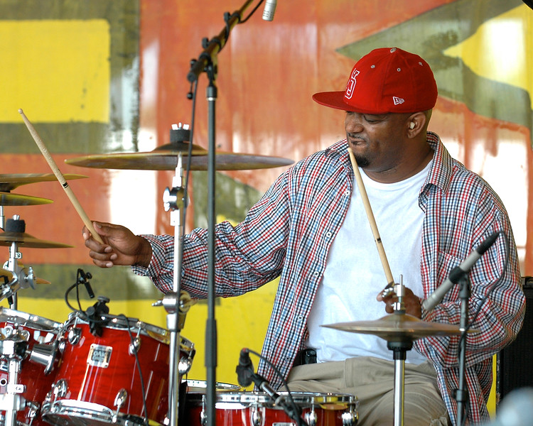 Terence Higgins performing live on stage with the Dirty Dozen Brass Band at the New Orleans Jazz & Heritage Festival on May 3, 2008.