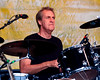Pete Thomas performing live on stage with Elvis Costello & The Impostors at the New Orleans Jazz & Heritage Festival on April 27, 2008,