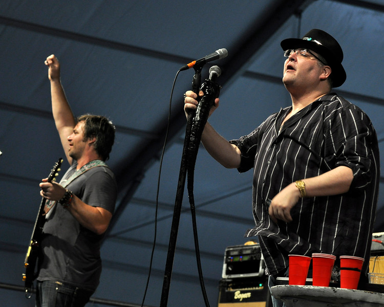 NEW ORLEANS, LA-APRIL 29: (L-R): Chan Kinchla and John Popper perform with Blues Traveler at the New Orleans Jazz & Heritage Festival on April 29, 2010. (Photo by Clayton Call/Redferns)