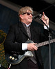 T-Bone Burnett performs at the New Orleans Jazz & Heritage Festival on April 27, 2007.