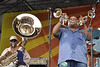 NEW ORLEANS, LA-MAY 1: Kirk Joseph (L) and Efrem Towns (R) perform with the Dirty Dozen Brass Band on the Acura Stage at the New Orleans jazz & Heritage Festival on May 1, 2010. NEW ORLEANS, LA-APRIL 29: Big Chief Monk Boudreaux (in blue) and Big Chief Juan Pardo (in red) perform with 101 Runners on the Jazz & Heritage Stage at the New Orleans Jazz & Heritage Festival on April 29, 2010. (Photo by Clayton Call/Redferns)