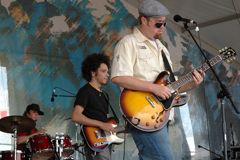 NEW ORLEANS, LA-APRIL 29: (L-R): Adam Deitch, Ian Neville and Eric Krasno perform with Dr. Klaw at the New Orleans Jazz & Heritage Festival on April 29, 2010. (Photo by Clayton Call/Redferns)