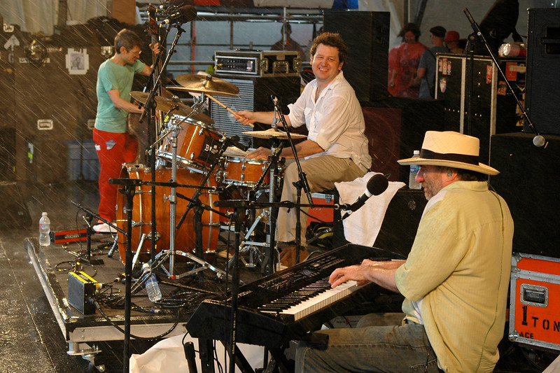 NEW ORLEANS, LA-APRIL 23: (L-R) James Singleton, Doug Belote and Jon Cleary perform in the rain at the New Orleans Jazz & Heritage Festival on April 23, 2010. (Photo by Clayton Call/Redferns)