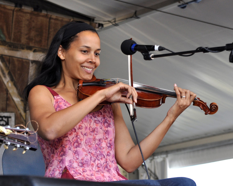 NEW ORLEANS, LA-APRIL 28: Rhiannon Giddens performs with Carolina Chocolate Drops at the New Orleans Jazz & Heritage Festival in New Orleans, LA on April 28, 2012. (Photo by Clayton Call/Redferns)