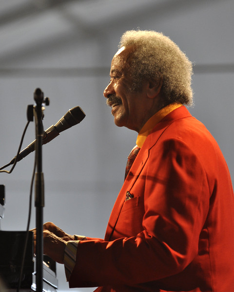 NEW ORLEANS, LA-MAY 1: Allen Toussaint performs with his Jazzity Project in the Jazz Tent at the New Orleans Jazz & Heritage Festival on May 1, 2010. NEW ORLEANS, LA-APRIL 29: Big Chief Monk Boudreaux (in blue) and Big Chief Juan Pardo (in red) perform with 101 Runners on the Jazz & Heritage Stage at the New Orleans Jazz & Heritage Festival on April 29, 2010. (Photo by Clayton Call/Redferns)