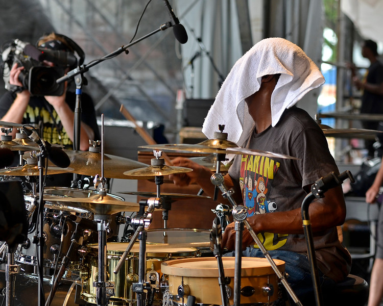 NEW ORLEANS, LA-May 3: Terrence Houston performs a drum solo with George Porter, Jr. & Runnin' Pardners at the New Orleans Jazz & Heritage Festival in New Orleans, LA on May 3, 2012. (Photo by Clayton Call/Redferns)