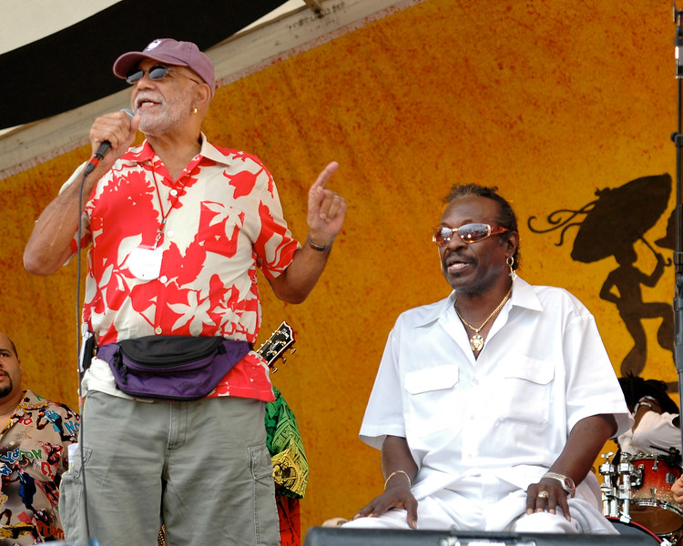 """Ed Bradley gives Bo Dollis of the Wild Magnolias his props after joining the band for a rousing version of """"Handa Wanda"""" at Jazzfest 2006"""