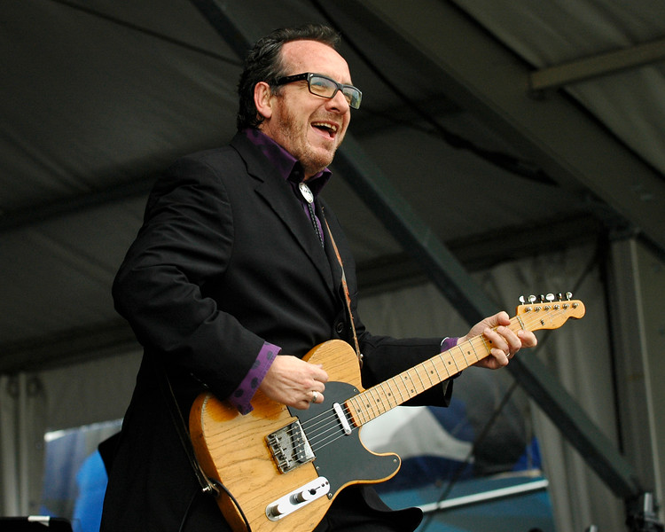 Elvis Costello and the Impostors performing live on stage at the New Orleans Jazz & Heritage Festival on April 27, 2008.