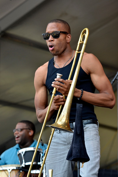 """NEW ORLEANS, LA-APRIL 29: Trombone Shorty & Orleans Avenue perform at the New Orleans Jazz & Heritage Festival in New Orleans, LA on April 29, 2012. (L-R): Dwayne """"Big D"""" Williams, Troy """"Trombone Shorty"""" Andrews (Photo by Clayton Call/Redferns)"""
