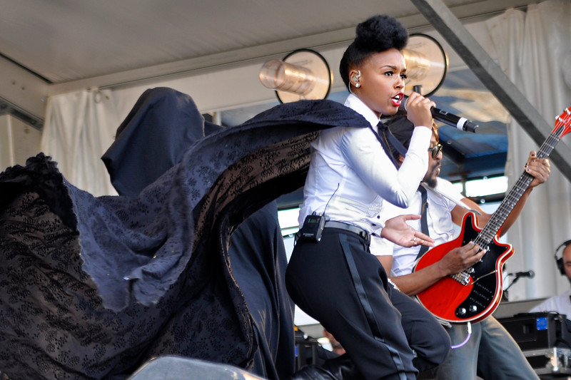 NEW ORLEANS, LA-APRIL 29: Janelle Monae performs at the New Orleans Jazz & Heritage Festival in New Orleans, LA on April 29, 2012. (L-R): Janelle Monae, Kellindo (Photo by Clayton Call/Redferns)