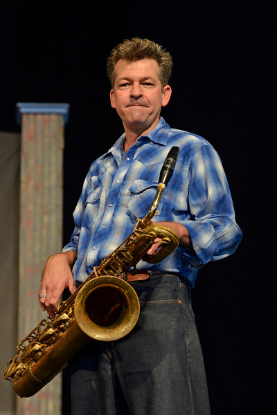 NEW ORLEANS, LA-APRIL 27: Derek Huston performs with Eric Lindell at the New Orleans Jazz & Heritage Festival in New Orleans, LA on April 27, 2012. (Photo by Clayton Call/Redferns)