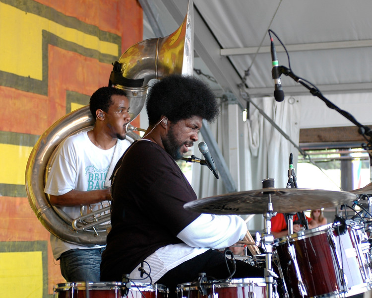 "Ahmir ""?uestlove"" Thompson and ""Tuba Gooding, Jr. performing live on stage with The Roots at the New Orleans Jazz & Heritage Festival on May 3, 2008."
