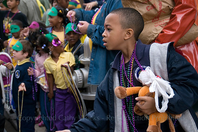 McDonogh children's Mardi Gras parade in French Quarter, starting on St. Phillip Street, New Orleans.  Children make costumes and floats, throw beads.  St. Phillip St., Royal, Conti, Jackson Square route.