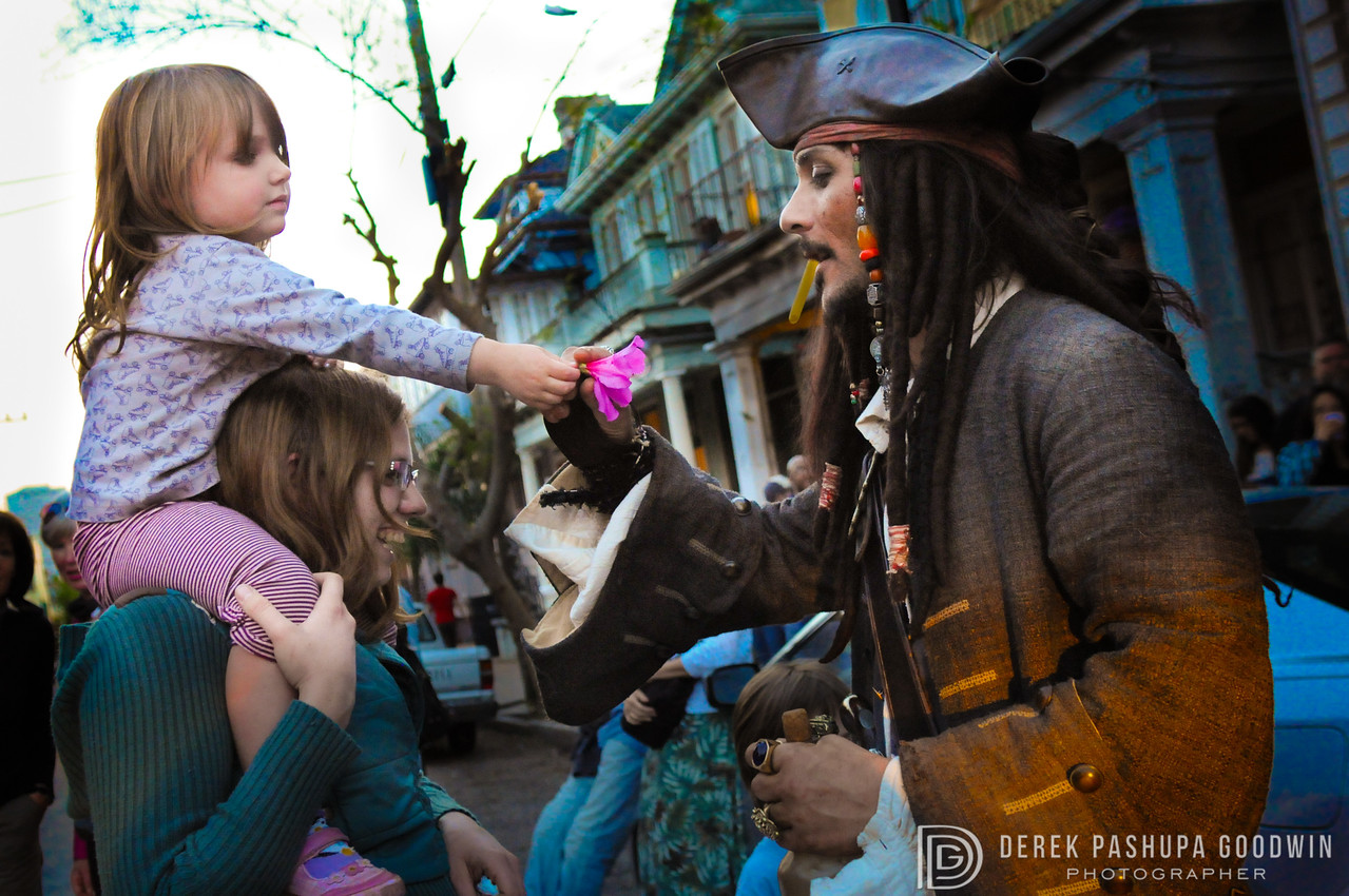 Girl gets flower to Captain Jack Sparrow in Pirate Parade 2010