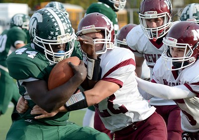 Tania Barricklo-Daily Freeman  Ne Paltz's Mike Pisciotta tackles tackles Spackenkill's Dhyquem Lewinson.