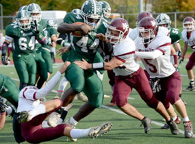New  Paltz's  Mike  Pisciotta  tackles  Spackenkill's Dhyquem Lewinson.