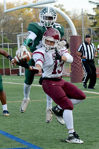 Tania Barricklo- Daily Freeman  Unsuccessful interception by Axel Rodriguez against Spackenkill's Nasir Milligan